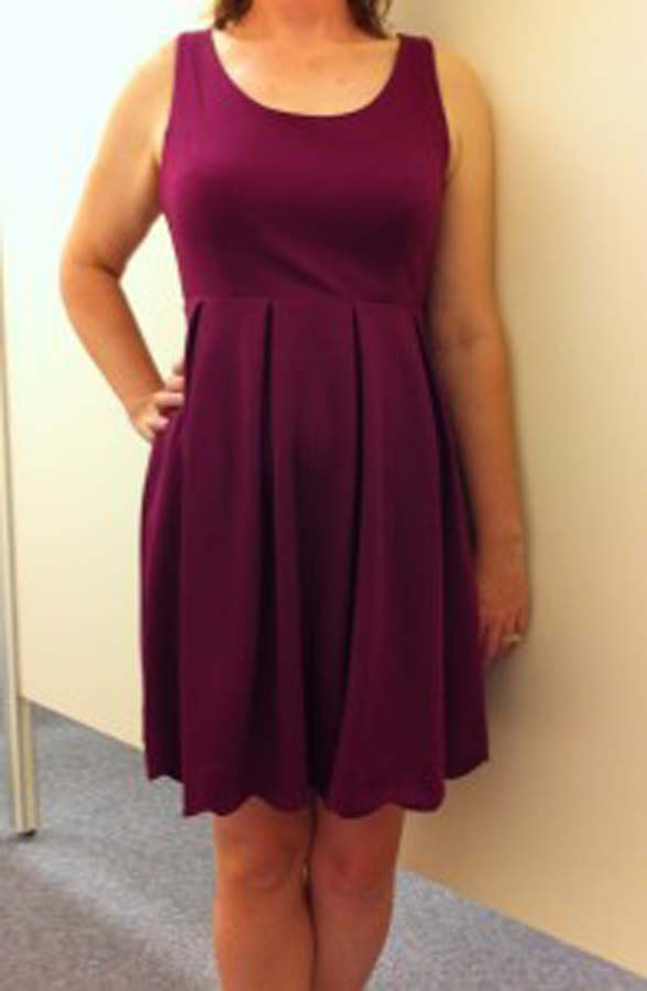 Purple empire waist dress with flared skirt