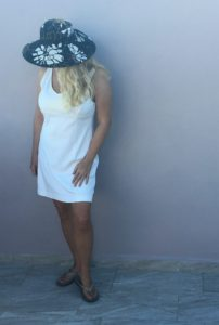 Cotton dress, wide brim hat, and comfy flip flops for casual Kentucky Derby themed party